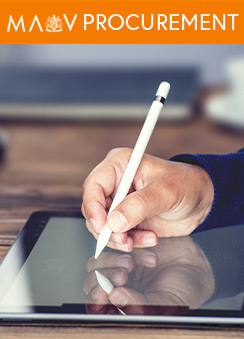 A photograph of a person's hand using a digital pen to write on a tablet device