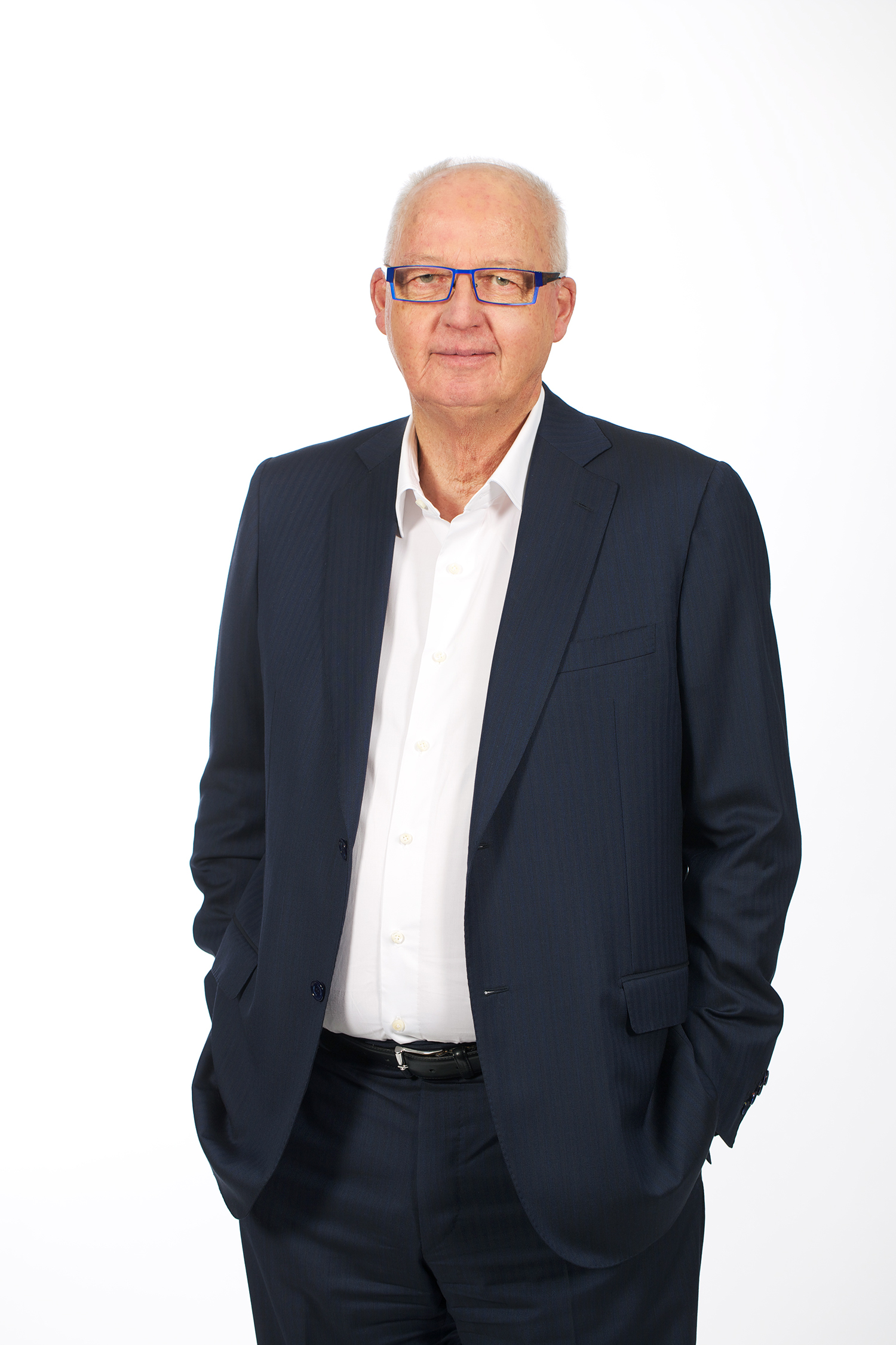 Rob Spence, MAV CEO, standing against a white background