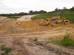 Long distance shot of machinery preparing the site