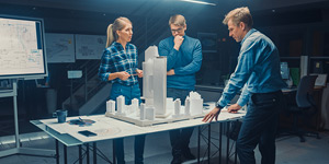 People of people discussing a 3D model of a city