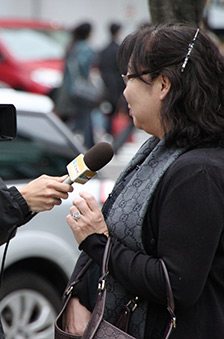 A side on shot of a person being interviewed
