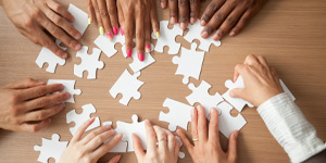 Aerial photo of hands doing a jigsaw