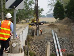 Construction workers building new Goads Road Bridge